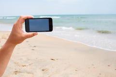Tir de photo sur le smartphone Image libre de droits