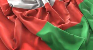 Tir en gros plan admirablement de ondulation hérissé par drapeau de l'Oman macro photographie stock