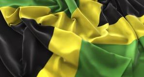 Tir en gros plan admirablement de ondulation hérissé par drapeau de la Jamaïque macro image stock
