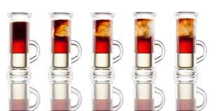 Tir multicouche d'alcool d'isolement sur le blanc Photographie stock