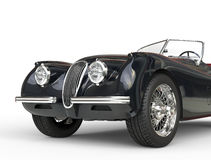 Tir noir de voiture de vintage sur le fond blanc - fin avant  Photos libres de droits