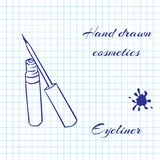 Tiré par la main cosmétiques de schéma sur le carnet empaquettent le fond Eye-liner dessiné avec un stylo Photographie stock