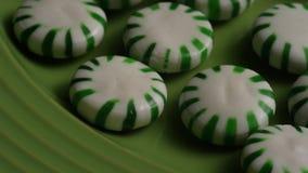 Tir tournant des sucreries de menthe poivrée clips vidéos