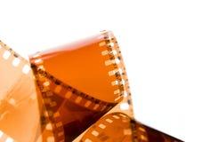 tira da película de 35 milímetros no branco Fotos de Stock Royalty Free