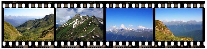 Tira da película de 35mm com tiros das montanhas Fotos de Stock Royalty Free