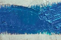 Tira da pintura azul na parede Imagem de Stock