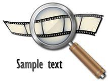 Tira de la película con la lupa Foto de archivo libre de regalías