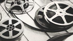 Tira de la película del vintage aislada en piso de madera foto de archivo libre de regalías