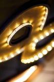 Tira do diodo emissor de luz em um quadro de madeira Foto de Stock Royalty Free