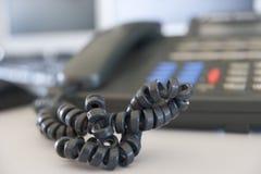 Tirado de una cuerda de teléfono Foto de archivo