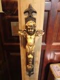 Tirador de puerta del cupido Fotos de archivo
