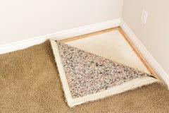 Tirados alfombra y acolchado en sitio Foto de archivo libre de regalías