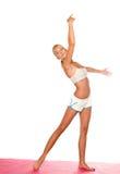 Étirage de femme de yoga Photographie stock