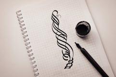 Tiraggio calligrafico con a penna ed inchiostro su carta fotografia stock libera da diritti