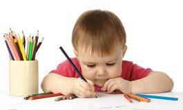 Tiraggio del bambino con i pastelli Fotografie Stock Libere da Diritti