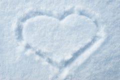 Tiraggio del cuore su smow fotografia stock libera da diritti