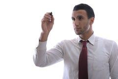 Tiraggio dell'uomo di affari con l'indicatore su spazio vuoto fotografia stock