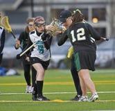 Tiraggio di Lacrosse delle ragazze Fotografie Stock