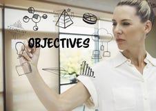 Tiraggio grafico di obiettivi da una donna di affari nel suo ufficio immagini stock libere da diritti