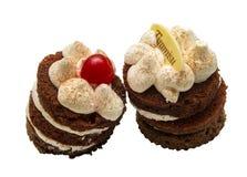 Tiramissu de deux gâteaux sur un fond blanc Photographie stock