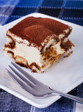 Tiramisu. Portion of tiramisu on a plate stock image