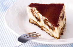 Tiramisu. Portion of tiramisu on a plate stock photo