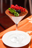 Tiramisu. With berries in fougere in the restaurant stock images