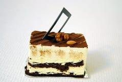 Tiramisu. Sweet tiramisu with coco, chocolate, apricot kernel & walnut kernel Royalty Free Stock Images