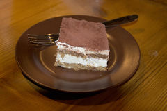 Tiramisu on a brown plate Royalty Free Stock Image