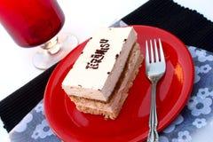 Tiramisu cake. On red plate Royalty Free Stock Photo
