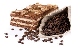 Tiramisu cake with bag of coffe Royalty Free Stock Photos