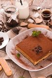 Tiramisu cake. Tiramisu cake with coffee bean on white dish stock photo