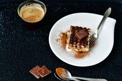 Tiramisu cake and coffee stock photography