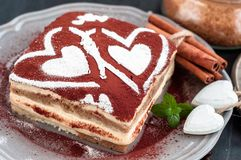Tiramisu cake decorated with hearts stock images