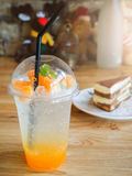 Tiramisu cake and Glass of orange soda on wooden table Royalty Free Stock Photos