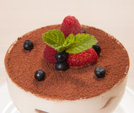 Tiramisu cake in glass with small fruits Royalty Free Stock Image