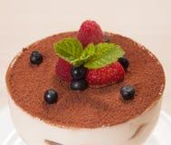 Tiramisu cake in glass with small fruits Royalty Free Stock Image