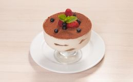 Tiramisu cake in glass with small fruits Stock Image
