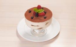 Tiramisu cake in glass with small fruits Stock Image