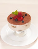 Tiramisu cake in glass with small fruits Stock Photography