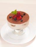Tiramisu cake in glass with small fruits Stock Photography