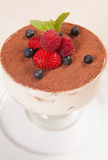 Tiramisu cake in glass with small fruits Royalty Free Stock Photography