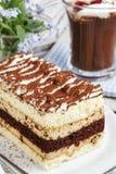 Tiramisu cake and irish coffee with cherries Royalty Free Stock Photo