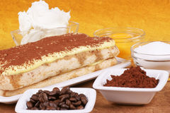 Tiramisu cake and its ingredients Royalty Free Stock Image