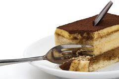 Tiramisu cake on the plate over white background Stock Photo