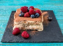 Tiramisu cake with raspberries and blueberries. Homemade tiramisu dessert. Traditional Italian cuisine Stock Photography