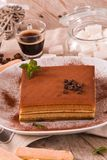 Tiramisu cake. Tiramisu cake with coffee bean on white dish stock image