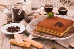 Tiramisu cake. Tiramisu cake with coffee bean on white dish royalty free stock photos