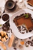 Tiramisu cake. Tiramisu cake with coffee bean on white dish stock photography