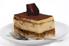 Tiramisu cake on white background Stock Images